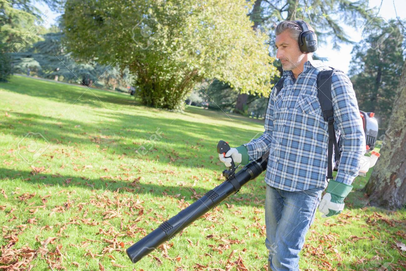 man using leaf blower